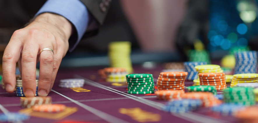 Man placing a bet at the casino