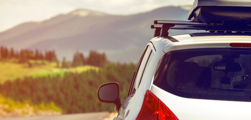 car for traveling with a roof rack on a mountain road